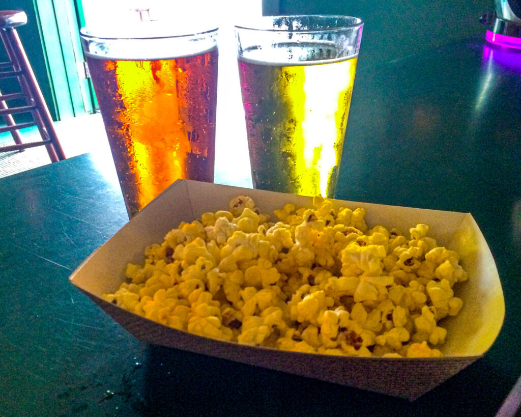 green parrot popcorn and beer