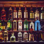 irish whiskey vs bourbon bar wall of bottles