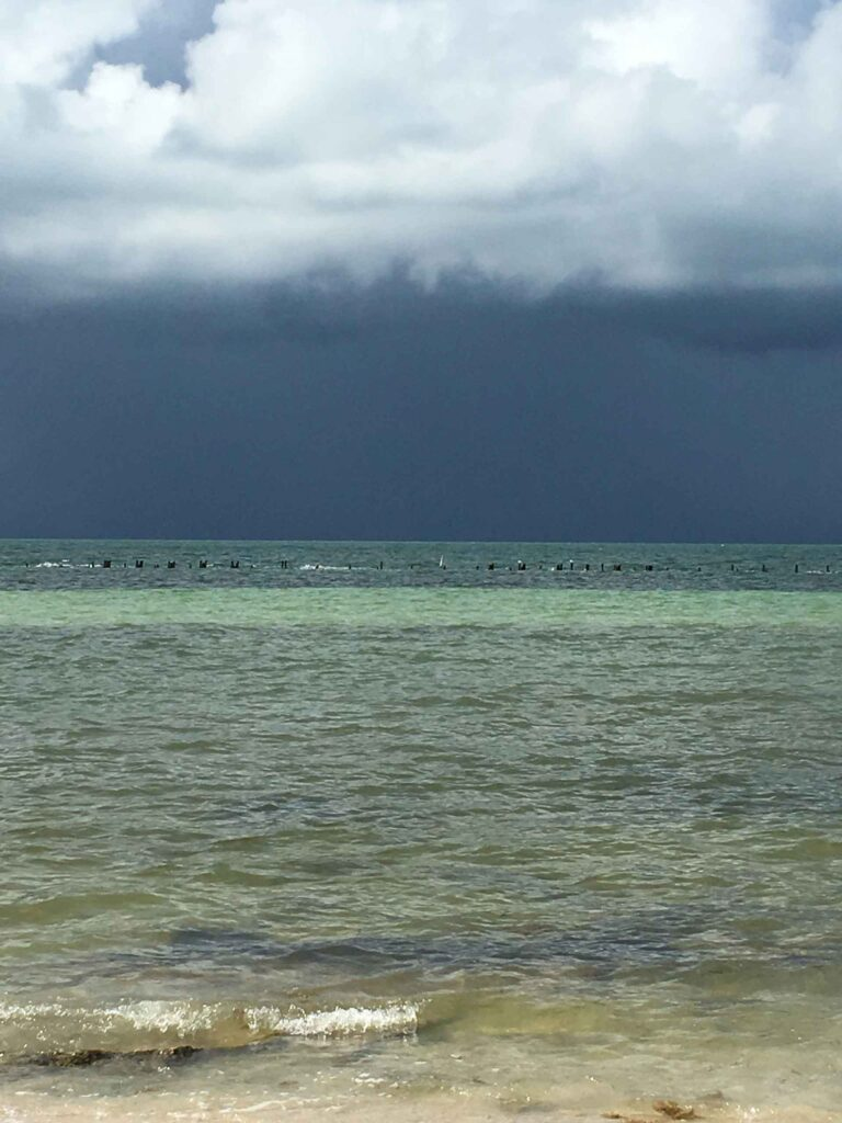 higgs beach storm coming over water