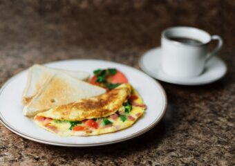 coffee cup with denver omlete on white plate