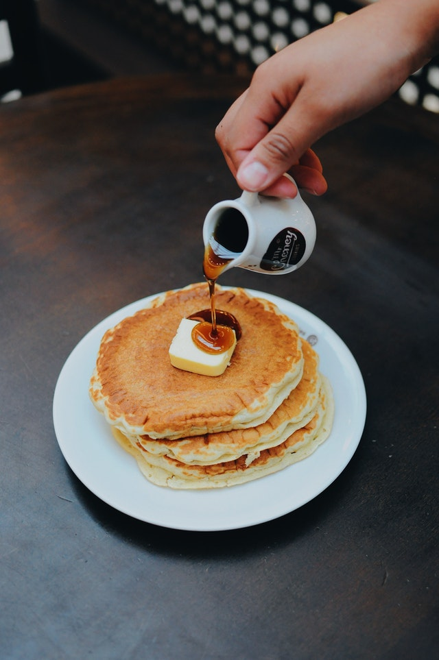 stack of pancakes with syrup being poured on them best breakfast in key largo