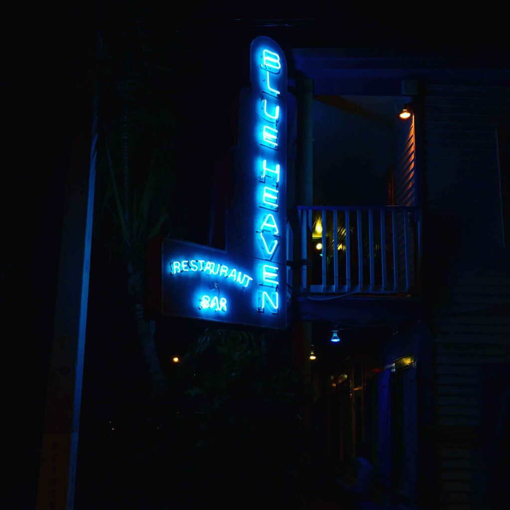 blue heaven key west sign at night